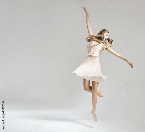 Fotobehang Dans Pretty and young ballet dancer