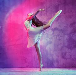 Flexible young ballet dancer on the dance floor