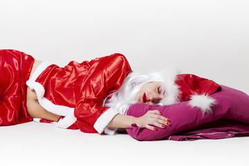 Tired Santa Claus sleeping