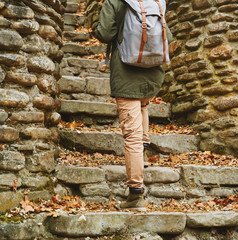 Unrecognizable woman walking up the stone staircase