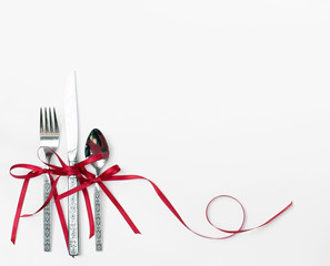 Holiday Silverware with Red Ribbon