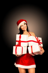 Santa hat Christmas woman holding christmas gifts