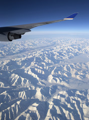 Flying over Chukotka mountains in Siberia, Russia