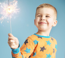 Delighted boy watching a sparkler