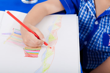 Hand of little child drawing