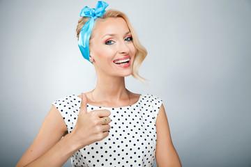 Smiling blonde woman posing