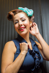 Elegant young female portrays classic pinup era