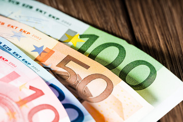 Euro banknotes on table