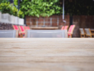 Wooden table top with dining table background