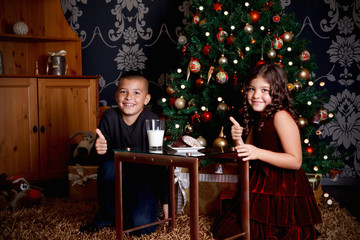 Sweet little children waiting for Santa Claus