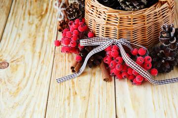 Wooden basket with pine cones