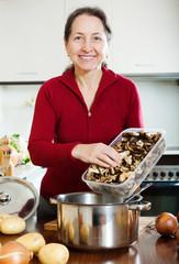 mature woman cooking lent diet soup