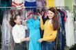 women chooses evening gown