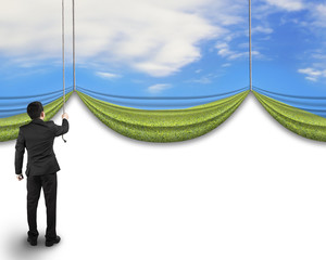 businessman pulling open natural sky meadow curtain revealed bla