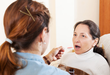 woman caring for illness senior mother