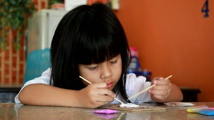 Asian girls are working intently art.