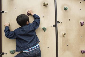 Boy to rock climbing