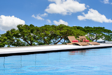 Relax Sun-beds near a swimming pool