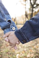 Boy who walk hand in hand