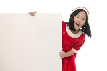 Beautiful asian girl in santa costume with whiteboard