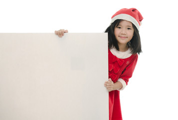 Beautiful asian girl in santa costume with whiteboard