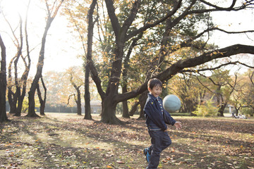 Boy playing with ball in the park