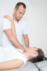 female patient with physical therapist