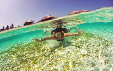 Healthy woman swimming in the ocean