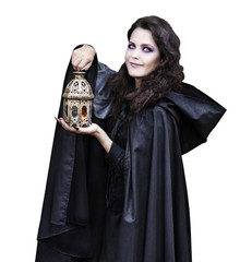 Girl in black mantle with lantern isolated on white