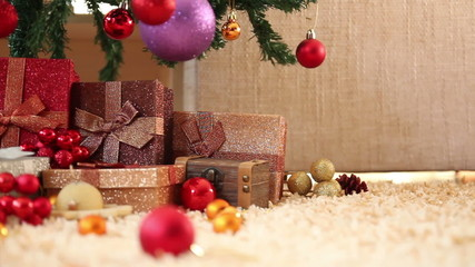 Christmas presents in front of christmas tree, dolly movement.