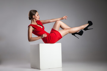 Fashion photo of young woman in red dress
