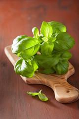 fresh basil leaves herb on wooden bacgkround