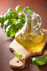 fresh basil leaves herb and olive oil on wooden bacgkround