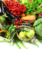 Fresh organic vegetables in wicker baskets, close up