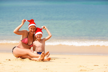 mother and son on the beach on Christmas