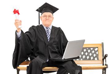 Proud mature graduate holding a diploma