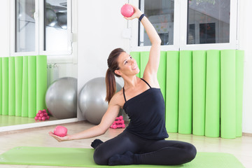 exercise with rubber weights