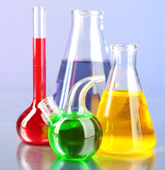 Different laboratory glassware with colorful liquid