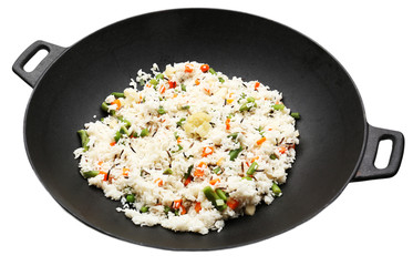 Tasty rice preparing in wok, isolated on white