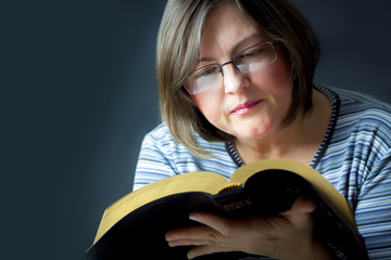 Adult Woman Reading a Bible