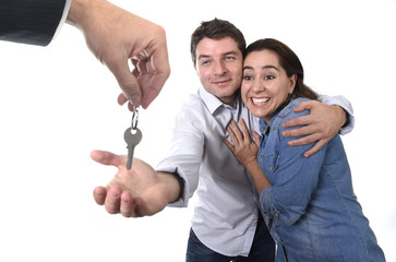 happy couple receiving new house key real state concept