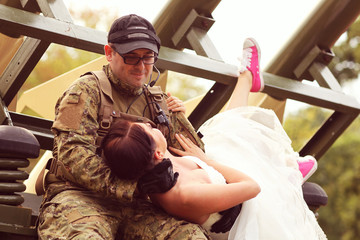 Bride with her groom wearing army suit