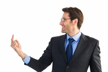 Smiling businessman pointing at a copy space
