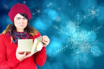 Unhappy brunette opening christmas gift