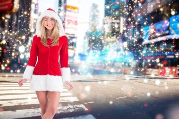 Composite image of pretty santa girl smiling at camera