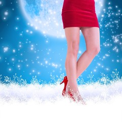 Composite image of lower half of girl in red skirt and heels