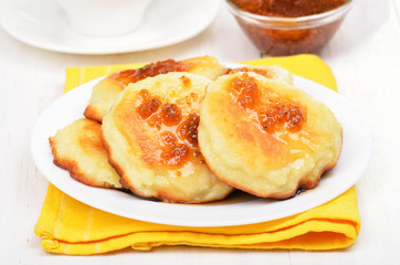 Cheese pancakes with yellow raspberry confiture