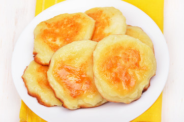 Cheese pancakes on white plate