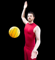 Volleyball player on red uniform isolated on black background
