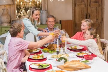 Three generation family enjoying christmas dinner together